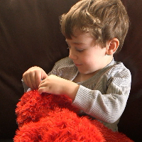 Play All Day Elmo Sizzle Nose Squeeze